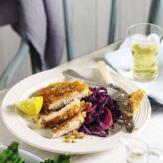 Pork schnitzels with apple and red cabbage sauerkraut recipe | delicious. magazine