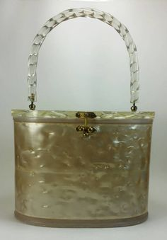 Check out this item in my Etsy shop https://www.etsy.com/listing/249371476/lucite-purse-pearlized-champagne-top