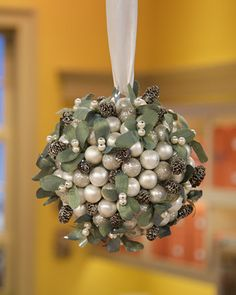Mistletoe Kissing Ball, add a red ribbon or some touches or red.