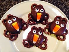 Turkey treats. Super easy. Dipped Oreos in melting chocolate, set on top of 3 chocolate covered pretzels. Quickly added candy eyes (picked up at Party City) and candy corn. Put in fridge for 10 minutes to set the chocolate. Done!