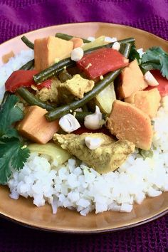 Cook coconut curry chicken and vegetables in the slow cooker for a quick and easy dinner recipe! This crockpot recipe is made using chicken breasts, green beans, sweet potato, curry powder, and coconut milk. You will love cooking this delicious chicken curry recipe and serving it over rice for dinner or lunch!
