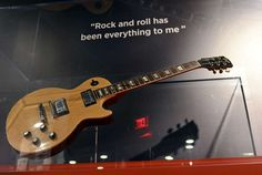 """The National Constitution Center exhibit, """"From Asbury Park to the Promised Land: The Life and Music of Bruce Springsteen,"""" 2/17/12-9/3/12 --- Bruce's 1967 Gibson Les Paul guitar and a Springsteen quote. (TOM GRALISH / Philadelphia Inquirer Staff Photographer)"""