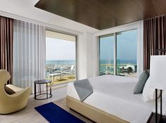 Indulge in luxury appointed guest rooms with balconies overlooking the mesmerizing Mediterranean Sea.