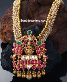22 carat gold antique necklace with Goddess Lakshmi pendant adorned with small basara pearls, rubies, emeralds and polkis.