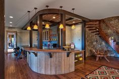 Smart basement bar makes perfect use of the available space [Design: Advance Cabinetry]