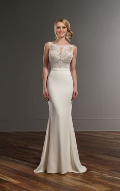 Beaded wedding dress with cathedral train by Martina Liana