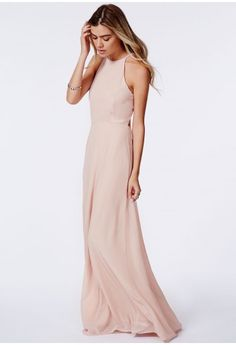 Nothing says summer like a gloriously pretty maxi dress, and this nude chiffon piece is ideal. The backless design and cute strappy detailing on the neck are perfect for gliding along in this season. Style with platforms and plenty of acces...