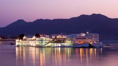 There are few buildings anywhere in the world that conjure up the romance and majesty of the Taj Lake Palace in Udaipur. The palace shimmers in the heat of the sun, rising serenely above Lake Pichola, its gleaming white walls reflected in the still water. Lazy speedboats chauffer guests to the palace steps and into …