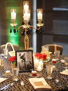 This Black and Gold Metallic Swirl linen makes for a great Roaring 20's themed party.     www.creativecoverings.com