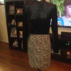 Style works dress size 8 Style works dress size 8. The top is long sleeves, mock turtleneck, velour. The bottom is a leopard print skirt. Zips in back. Styleworks Dresses