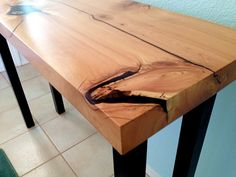 Natural Live Edge Modern Wall or Sofa Table, made from Alligator Juniper. Includes organic inclusions, no inlay, just pure wooden brilliance. Steel legs with patina finish. This table keeps the live raw edges on the surface area preserved in time with epoxy.