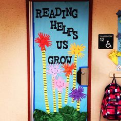 """This is a great classroom door that combines spring themes with Truffula Trees from the Dr. Seuss book """"The Lorax."""""""