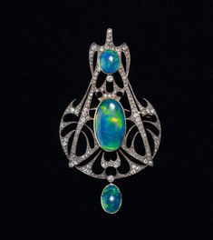 Opal and Diamond Pendant by Henri Verver, ca. 1910. Eminent French jewellery house famous for its Art Nouveau designs.