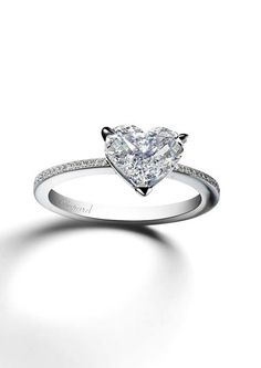 Chopard Passion for Happiness diamond engagement ring featuring a delicate heart-shaped diamond on a narrow band glittering with pavé diamonds. Heart Engagement Rings, Engagement Ring Shapes, Engagement Ring Settings, Engagement Jewellery, Heart Wedding Rings, Engagement Bands, Wedding Jewelry, Wedding Bands, Heart Shaped Diamond Ring