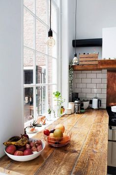 black pendant lights in sunny modern kitchen. / sfgirlbybay