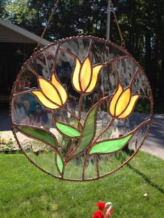 Round yellow orange tulip flowers stained glass by ColoursintheAir Dragonfly Stained Glass, Stained Glass Suncatchers, Stained Glass Flowers, Stained Glass Designs, Stained Glass Panels, Stained Glass Projects, Stained Glass Patterns, Leaded Glass, Stained Glass Art