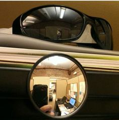 set up sunglasses so you can see who's coming up from behind you at your work desk