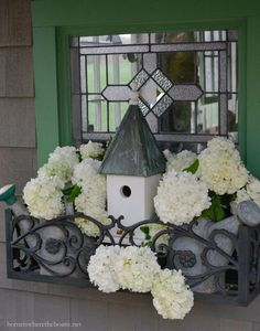Potting Shed Window Box with Watering Cans, Bird House and Snowball Viburnum.