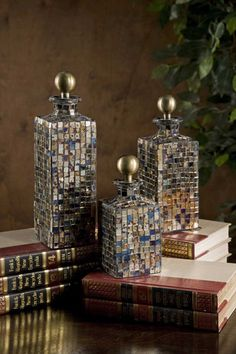 This set of three multi-tonal squared mosaic glass bottles feature brass stoppers and add a shimmer to any tabletop. Product Description Product Material: 85% G