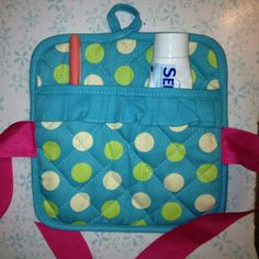 Sew ribbon to a pot holder for a toothbrush/toothpaste travel kit. Throw in the wash at the end of your trip!
