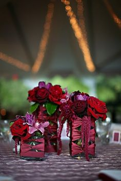 purple and burgandy reception wedding flowers,  wedding decor, wedding flower centerpiece, wedding flower arrangement, add pic source on comment and we will update it. www.myfloweraffair.com can create this beautiful wedding flower look.