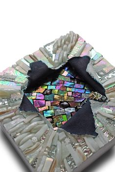 Explore Lin Schorr's photos...  This is a great effect of Layered Mosaiv on Fabric...