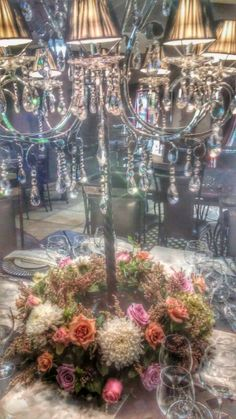 Galagos candelabra with surrounded by a beautiful wreath floral arrangement. Table Arrangements, Floral Arrangements, Protea Wedding, Wedding Decorations, Wedding Ideas, Daisy Flowers, Country Estate, Candelabra, Corporate Events