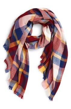 This fun plaid scarf with soft fringe adds a rustic charm when paired with an oversized sweater and jeans.