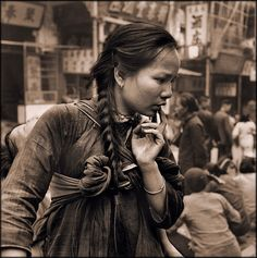 Young Mother Carrying A Child On Her Back In The Market, Hong Kong Island [c1946] Hedda Morrison #vintage #photography #mother_and_child