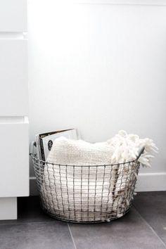 ShopStyle Home Decor Tip >> Store your favorite cozy winter blankets in a chic oversized metal basket to keep your living room organized and tidy.