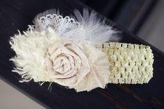 Use this idea of flowers and feather to put on a yarn wreath for a vintage feel