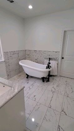 Marble look tile Installation of marble look tile in a bathroom renovation Houston Bathroom Design Small, Bathroom Layout, Bathroom Interior Design, Bathroom Ideas, Master Bathroom Designs, Interior Ideas, Master Bath Tile, Budget Bathroom, Marble Tile Bathroom