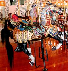 Prince — The king horse (or lead horse) of the carousel. --   The center of activity is undeniably the1909 Looff Carousel. This carousel, with its 54 carved horses, giraffe, tiger and Chinese dragon chairs, is considered America's most beautiful and well preserved hand carved carrousel .Riverfront Park