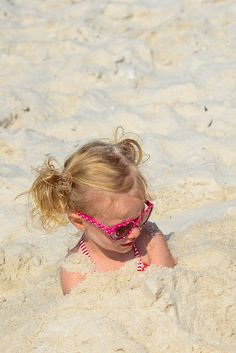Only a kid would like this much sand covering their body.....