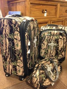 NEW WITH TAGS....Western designed luggage with camo and cross with rhinestones. Set price asking $299.95