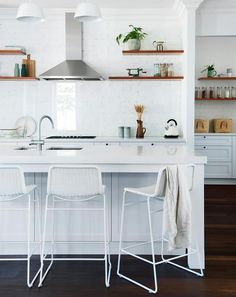 Smart and cost-effective, the splashback is white-painted recycled brick fronted by a pane of glass. Recycled Brick, Art Deco Home, Eco Friendly House, Australian Homes, Splashback, Kit Homes, Kitchen Furniture, Home Renovation, Kitchen Remodel
