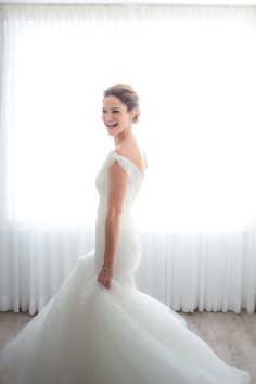 Gorgeous, laughing bride on her wedding day is always a beautiful and timeless photo to have. :)