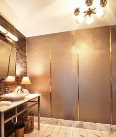 Maya Romanoff Beadazzled wallcovering, a hand applied glass bead wall paper featured in a powder room designed BA Torrey Interiors in NYC Learn more about Beadazzled at: http://www.mayaromanoff.com/product/beadazzled