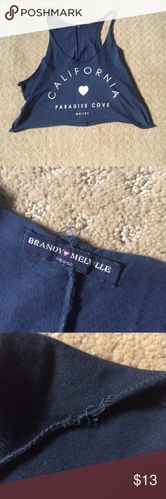 Brandy Melville California Tank Brandy Melville California tank top. In good used condition; the only flaw is some pulling of the stitching as shown in picture. Feel free to ask any additional questions.   💕 please make offers through offer button 💰 bundle for a 20% off discount  🚬🐶 smoke & pet free home  🚫 sorry no trades Brandy Melville Tops Tank Tops
