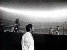 Brian Epstein watching The Beatles at Shea Stadium
