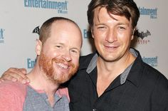 Joss Whedon and Nathan Fillion fighting with lightsabers