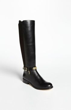 "MICHAEL Michael Kors 'Arley' Boot Was: $274.95 Now: $199.90 An exposed side zip and smooth elastic panels ease the fit of a sleek knee-high boot finished with logo-etched hardware. Approx. heel height: 1 1/4"" (size 9). Approx. boot shaft height: 15 3/4""; 13 1/2"" calf circumference. Stretches to fit wide calf. Side zip closure. Leather and textile upper/leather lining/rubber sole."