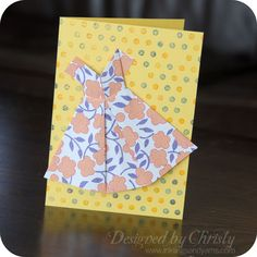 An adorable origami dress card from How About Orange has been floating around Pinterest for a few weeks. I thought it was so much fun that I made a variation of it for this week's make-and-ta…