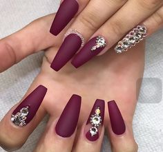 Perfect maroon nail art design for long nails The matte color of the maroon polish makes the entire design look even elegant The addition to the matte background, embellishments are also added on top for effect Ongles Bling Bling, Bling Nails, Fun Nails, Gold Nails, Rhinestone Nails, Matte Nails, Stiletto Nails, Coffin Nails, Acrylic Nails