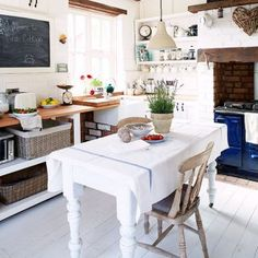 White country cottage kitchen diner with blue Aga range Aga Kitchen, Cozy Kitchen, Little Kitchen, Dining Table In Kitchen, Kitchen Ideas, Copper Kitchen, Rustic Kitchen, Vintage Kitchen, Dining Room