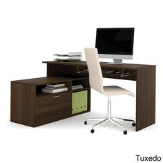 This compact adjustable computer workstation features two layers and an oversized pedestal that is fully reversible for maximum flexibility. An L-shaped desk with a modern-tuxedo or maple finish and silvertone hardware, it is perfect for small spaces.