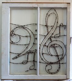 This custom window features a bass and treble clef that is in an original antique frame. It is Meticulously crafted piece by piece with aged barb wire. A beautiful design with flourish and character. Animals, Birds, Names, Logos, Instruments, States, People, Trees, Signs. Pet passed away and you still have a picture? no problem! send it and I'll bring it back to life with barbed wire. If you want that old barn wood type deal look, I'm telling you I got it. Name it I'll Frame it! yeh man.