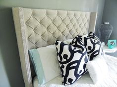 DO or DIY | How to Make a Tufted Headboard.   Uses foam mattress pads and a cheap sheet as a cheap substitute for foam and batting.
