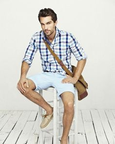 Try pairing a white and blue gingham long sleeve shirt with light blue shorts for a casual level of dress. This outfit is complemented perfectly with beige leather boat shoes.