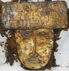 Analogues. This is Tibetan, with a great article at the origin site for context. The golden burial mask of Gu-ge.